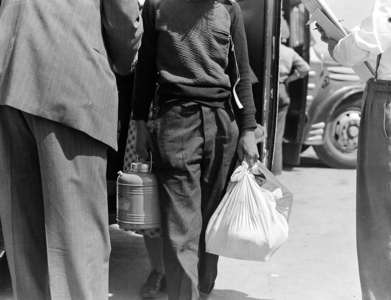 Stockton, CA, These evacuees of Japanese ancestry are bringing fresh food with them to this Assembly Center, photo by Dorothea Lange, 1942