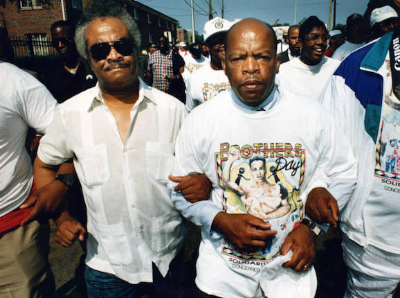 Representative John Lewis with Representative Tyrone Brooks arm-in-arm at the Brothers Day March, 1992