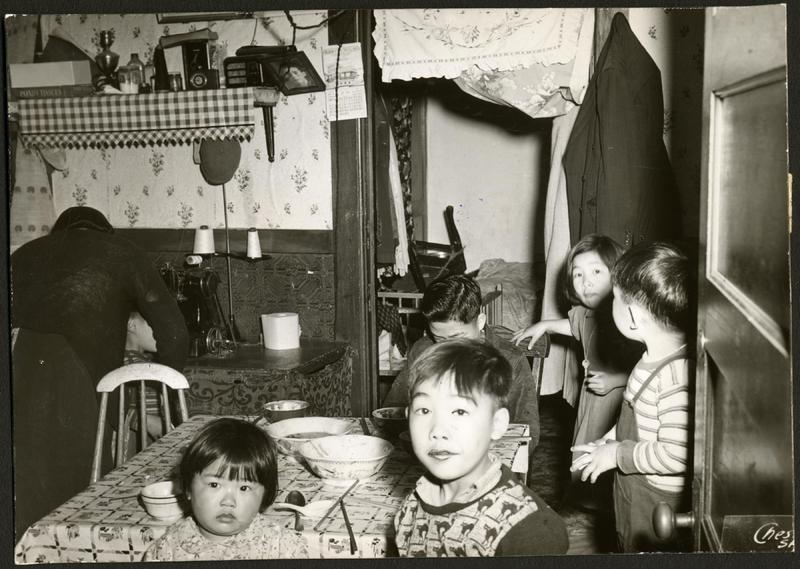 Chinese family in cramped tenement, ca. 1939