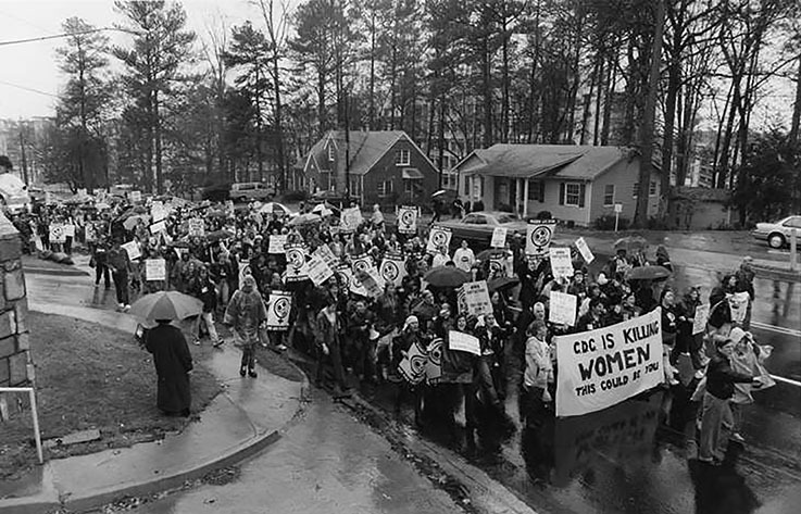 Photograph -- About 300 people gathered at the Centers for Disease Control to protest its handling of women with AIDS; 100 were arrested, Atlanta, Georgia, December 3, 1990.