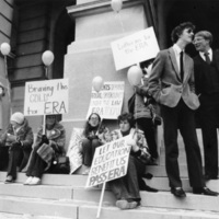 Female students at pro-Equal Rights Amendment demonstration in front of State House, while two young suited males look on, Atlanta, Georgia, 1980s.