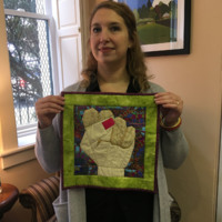 Katharine Rapkin with her protest quilt