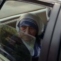 Mother Teresa visiting the Gift of Grace House,  a home for women with AIDS her order opened in 1994, Atlanta, Georgia, June 13, 1995.<br />