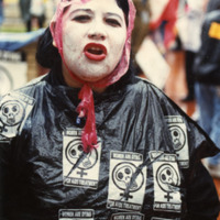 Photograph -- woman protestor at Center for Disease Control, 1990