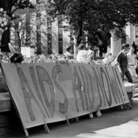 """""""AIDS Aid Now,"""" sign at the Georgia State Capitol AIDS rally and vigil, Atlanta, Georgia, May 7, 1988."""