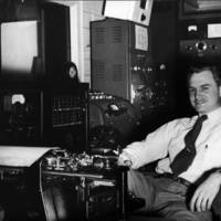 Man at typewriter in WSB control room