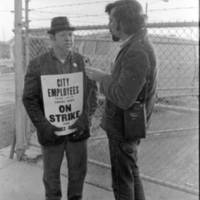 """<br /> AFSCME Local 1644-led sanitation strike, Atlanta, Georgia, March 1970. These photographs are taken outside the City of Atlanta Construction Department office and warehouse (110-111 Hill Street). Protestors are apparently attempting to block strikebreakers from crossing the picket-line and entering the office area. The photograph series is labeled """"Garbage Strike."""""""