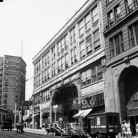 Exterior and street view of the Peachtree Arcade, Peachtree Street, Atlanta, Georgia, August 7, 1944. Peachtree Arcade, at Five Points in downtown Atlanta,  was the location of night school classes when the first female students were admitted.