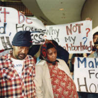 Robert Abrams and Carolyn Abrams pose as Mary and Joseph during a demonstration against homeless phobia, organized by the People for Urban Justice, 1991