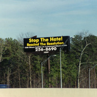 """Photograph -- Billboard: """"Stop the Hate! Rescind the Resolution""""."""