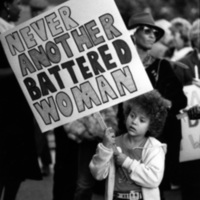 """Rally protesting violence against women ('Battered Women""""), Dalton, Georgia, 1980s? Pictured is four-year old Chelsea Friauf-Evans holding a sign that reads """"Never Another Battered Woman."""""""
