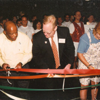 Photograph of John Lewis, Brook Glaglke and  Emily Salierscutting the ribbon opening the Welcome Center.