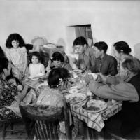 Latino family at the dinner table for meal, El Cerrito, San Miguel County, New Mexico, ca. 1941
