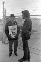 AFSCME_Local_1644led_sanitation_strike_Atlanta_Georgia_March_1970_These_photographs_are_taken_outside_the_City_of_Atlanta_Construction_Department_office_and_warehouse_110111_Hill_Street_Protestors_are_apparently_attempting_to_block_strikebr.jpg