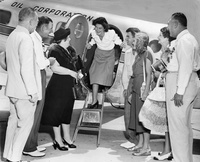 Louise Suggs steps off airplane after returning home with the Women's British Amateur golf title, 1948<br />